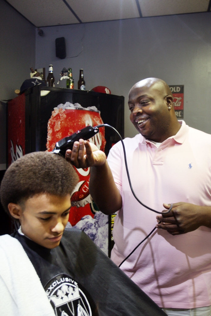 Michael Todd, 31, of Victoria, owner of Exclusive Kutz talks about how he got started as a barber as he cuts Jabari Arkadie, 18, of Cuero hair in Victoria. Todd has been a professional hair dresser since 2003.