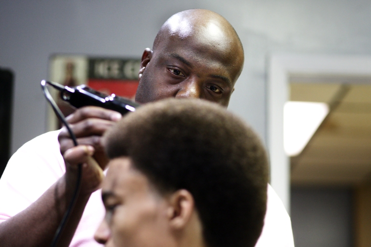 Owner of Exclusive Kutz, Michael Todd, 31, of Victoria, concentrates as he cuts Jabari Arkadie, 18, of Cuero hair. Professionals from Exclusive Kutz recently competed in a barber battle in Corpus Christi recently and plan to go to more.